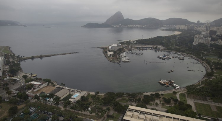This July 27, 2015 aerial photo, shows Marina da Gloria in Rio de Janeiro, Brazil. Construction is underway on a project to cap a pipe that long spewed raw sewage into the marina, the starting place for the Olympic sailing events. Yet Associated Press testing of the marina's water quality found it laden with sewage viruses. (AP Photo/Leo Correa)