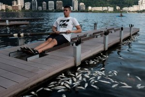 Members of a local rowing club practice among floating dead fish at the Rodrigo de Freitas Lagoon that will host rowing and canoeing events during Rio 2016 Olympic Games. (Yasuyishi Chiba/AFP/Getty Images)